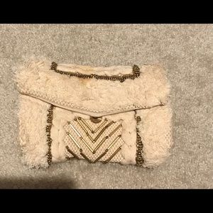 Tan and gold clutch